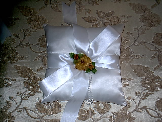 Item 159 Gold ring pillow